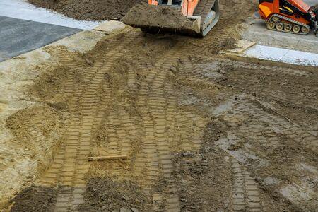 Construction bulldozer leveling and moving soil landscaping works on the earthmoving Standard-Bild