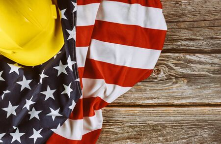 US. federal holiday of Labor Day is United States America of engineer yellow plastic construction helmet, american patriotic background