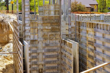 Formwork of the foundations of building under construction using temporary metal
