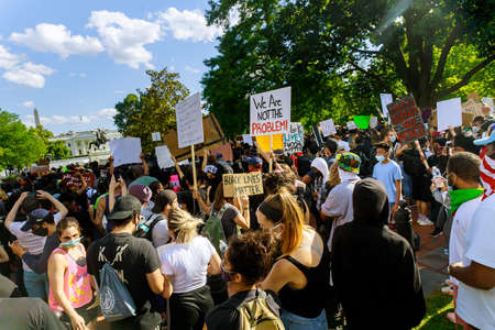 WASHINGTON D.C., USA - MAY 31, 2020: Protest Black Lives Matter protesters march after death George Floyd, group standing against White House Donald Trump president US Editorial