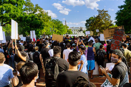 WASHINGTON D.C., USA - MAY 31, 2020: Protest after George Floyd death, Black Lives Matter group standing against White House president Donald Trump