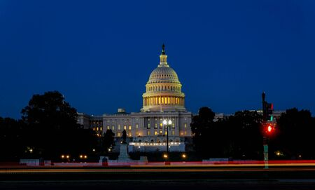 The United States Capitol building with the dome lit up at night the Senate House sides of the building