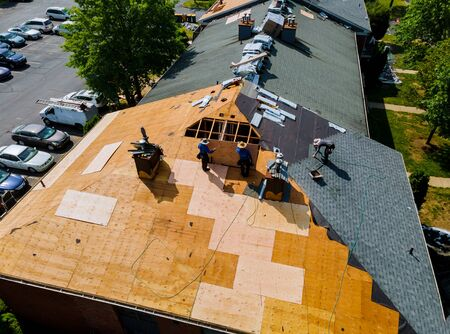 Construction worker on a renovation roof the house installed new shingles