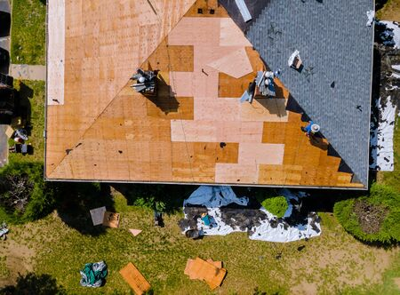 Removal of old roof replacement with new shingles of an apartment building Stock Photo