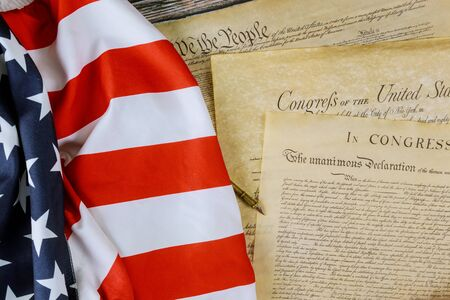 American Flag We the people and Preamble to the Constitution of the United States Declaration of Independence with July 4th. Stock Photo