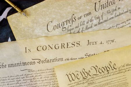 Declaration of Independence U.S. document of American constitution We the people with USA Flag. Stock Photo