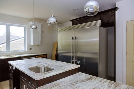 New white kitchen installed furniture cabinets and countertop with appliances