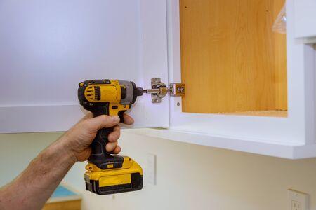 Modern fixing cabinet door hinge adjustment on kitchen cabinets, home improvement