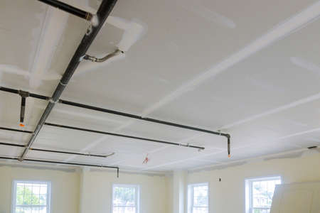 Fire sprinkler in automatic ceiling office building focus at selective on ceiling background