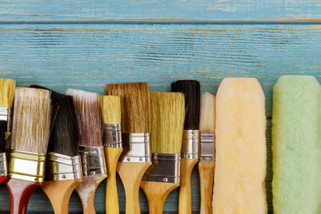 Painting tools paint brushes roller various on the wooden table Standard-Bild