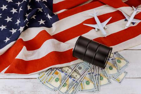 Oil barrels on US dollar oil business, rising world oil prices brand USA flag model airplane