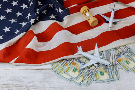 Rising world prices USA flag model airplane on US dollar business
