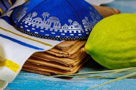Jewish religious symbol festival of Sukkot traditional symbols Etrog, lulav, hadas, arava praying book kippah Tallit