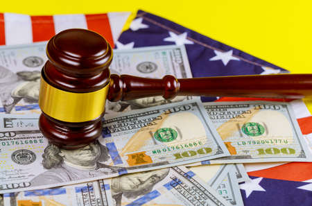 USA lawyers in the US legal office with judges gavel on American flag on us dollar currency american cash