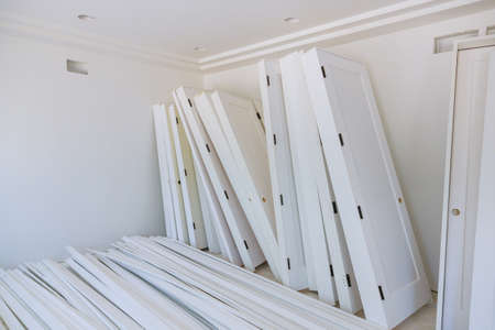 Installation interior wooden stacker doors a wait installation for new apartment building