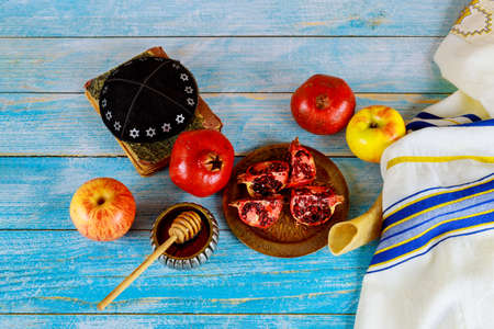 Table in the synagogue are symbols of Rosh Hashanah apple and pomegranate, shofar talith
