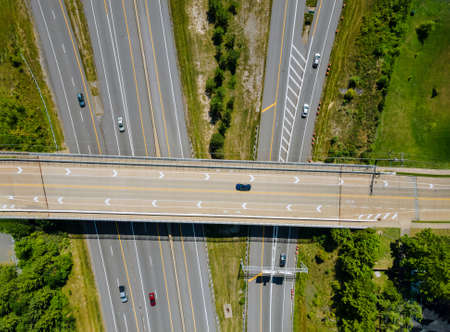 Bridges, roads top aerial view of highway of urban elevated road junction and interchange overpass in city with traffic Cleveland Ohio US Stock Photo