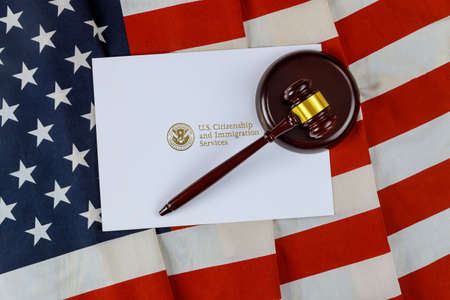 Judge's gavel, lawyers office deportation US Citizenship and Immigration Services of naturalization with USA flag
