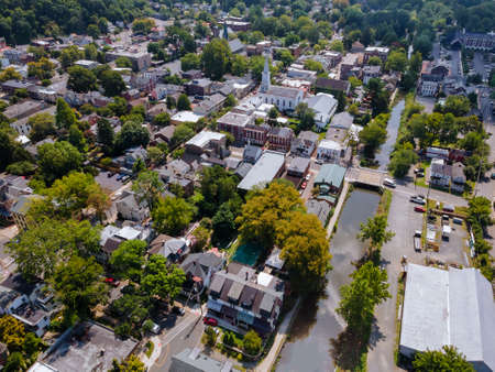Scenic seasonal landscape from above aerial view of a small town countryside of Lambertville New Jersey USA in the historic city New Hope Pennsylvania US.