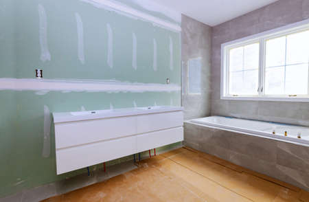 Construction details with industry renovation shower in tiled bathroom with windows molding