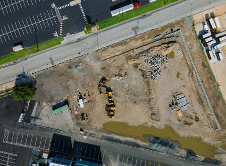 Water and sewage pipes stacked in ground during plumbing construction site