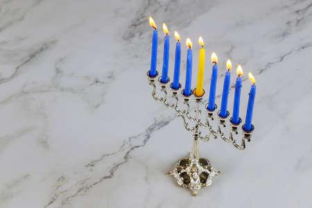 Hanukkah menorah orthodox jewish holiday symbol brightly glowing candles