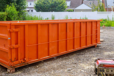 Construction trash dumpsters on metal container, house renovation. Imagens