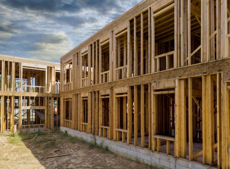 Building of New Home Construction exterior wood frame and beam construction against a blue sky
