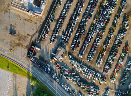 Aerial view of many used car auction lot parked distributed in a parking. Stock Photo