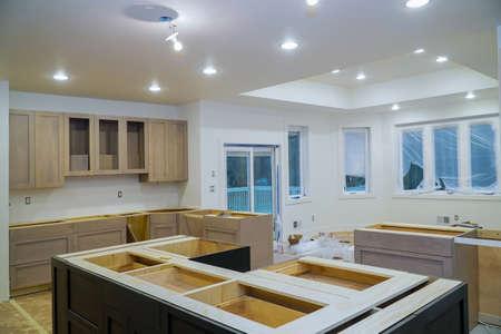 Interior design construction of kitchen remodel with cabinet maker installing home improvement custom