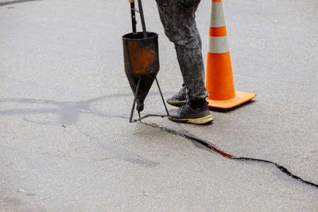 Asphalt seal restoration work filler asphalt crack repair, liquid, joint sealant joint of the fixed road
