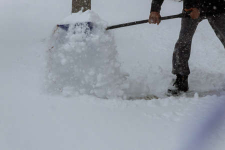 Service cleaning snow winter with shovel after snowstorm yard