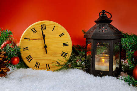 Christmas lantern with magic winter Holiday beautiful scene with snow decoration in the evening New Year design clock counting down