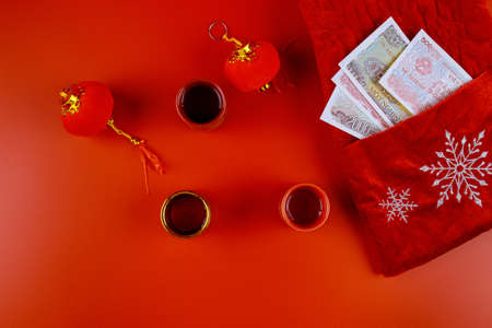 Lunar new year decoration traditional with Chinese Asian Vietnamese New Year Money Vietnamese dong on red envelope Tet is lucky money