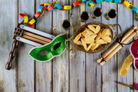 Carnival with noisemaker Purim jewish holiday Hamantaschen cookies