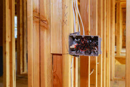 Installing electric sockets on the wall in new home new home construction