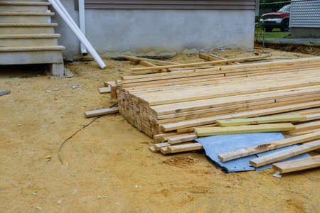 Wood timber construction material stock in joinery on the construction site