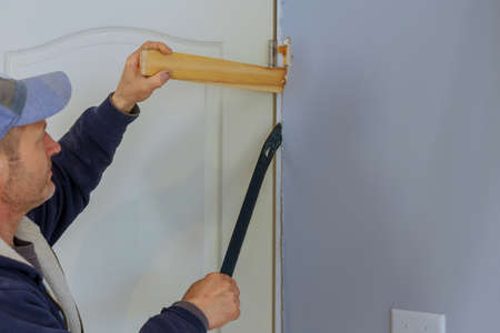 Preparation installing in new home wooden of interior room doors on under construction