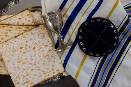Passover holiday traditional celebration with cup wine kosher matzah unleavened bread on of Jewish Pesach