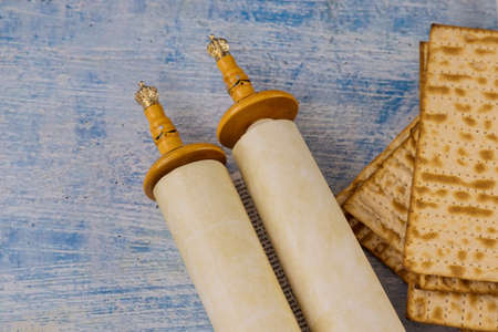 Pesach Jewish traditional celebration with Torah Scrolls, kosher matzah on passover holiday