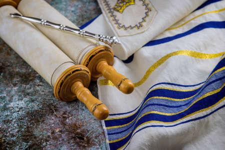 Jewish Orthodox holidays, during prayer items prayer shawl tallit with torah scroll in a synagogue