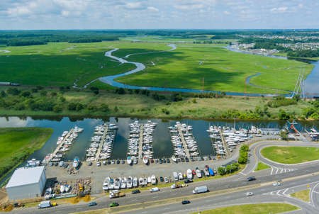 Aerial panoramic view harbour doc for many boat on floating near the ocean in USA