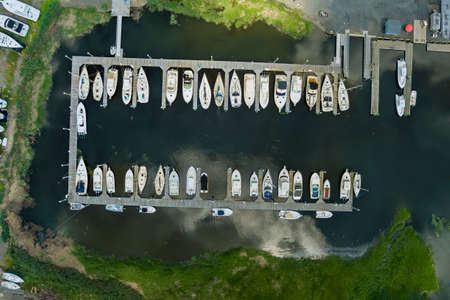 Amazing panoramic view little harbour for many boat floating near the ocean in US