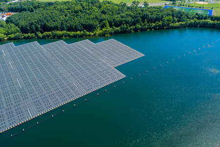 Aerial view of Floating solar panels cell platform system park farm on the lake