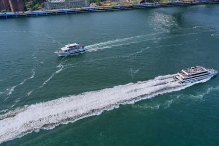 Panoramic view on yacht transporting passengers on Hudson river New York Manhattan USA