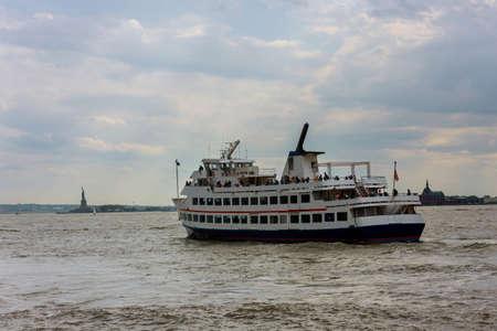 Panoramic view on yacht transporting passengers on Hudson river near Statue of Liberty New York Manhattan USA
