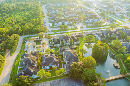 Above Houston , Texas suburb area west of downtown with morning golden hour sunlight aerial view