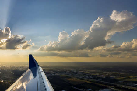 The plane is taking off at altitude during colorful sunset