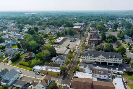 Aerial view over the small town landscape residential sleeping area roof houses in Sayreville NJ USA 免版税图像