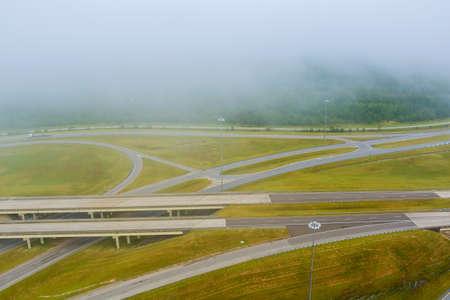 Early morning landscape foggy bridge across 65 Highway near Satsuma, Alabama